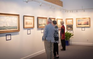 Guests viewing the artwork.