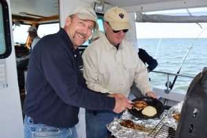 Captain Billy and David serving up a seafood lunch.
