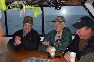 Tony Dora, Gene and Larry in the cabin.