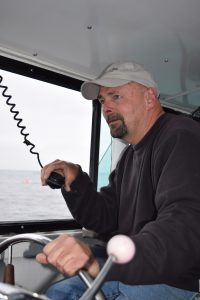 Captain Eddie Green at the helm.